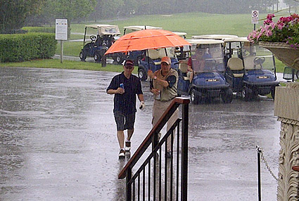 It never rains it pours. Eric and Jack at C.L.E. Leasing Golf Day
